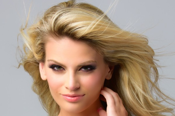 "alt = ""Blonde model showcasing blonde hair color"""