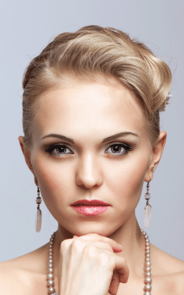 "alt=""Blonde model looking showcasing a hair style in the hairstyle gallery"""