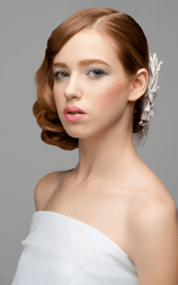 "alt=""Red haired model showcasing a beautiful hair style and undo in the hairstyle gallery"""