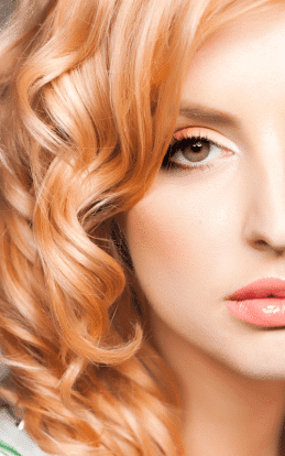 "alt=""Strawberry blonde model showcasing a beautiful hair color"""