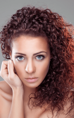 "alt=""Brunette model showcasing a beautiful hair color in the hairstyle gallery"""